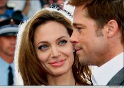 За 14 миллионов долларов Анжелина Джоли и Бред Питт продали фото своих близнецов